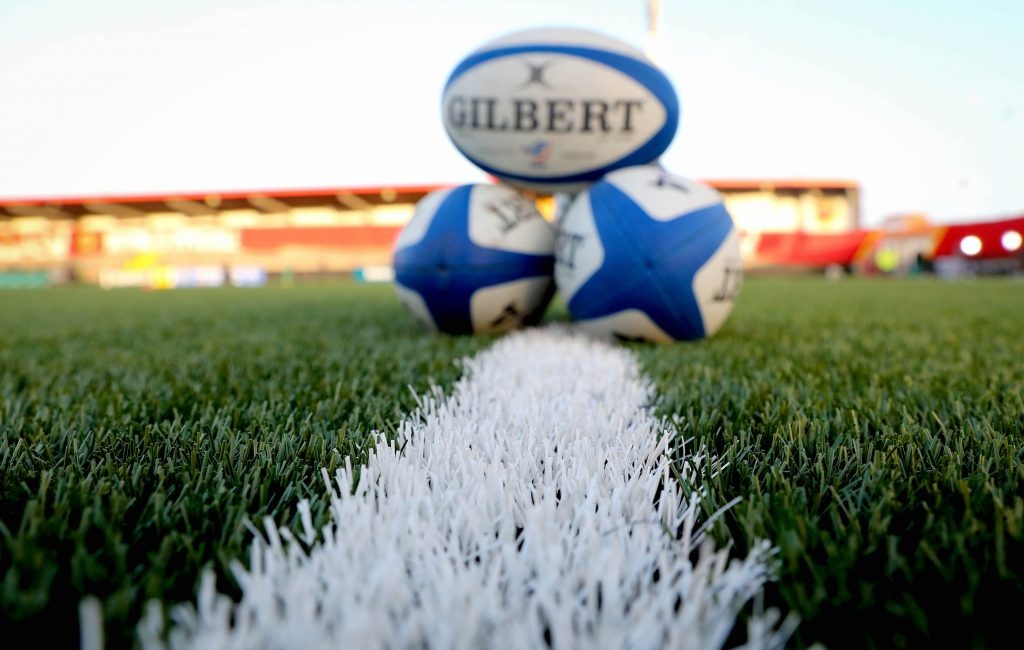 rugby balls on pitch